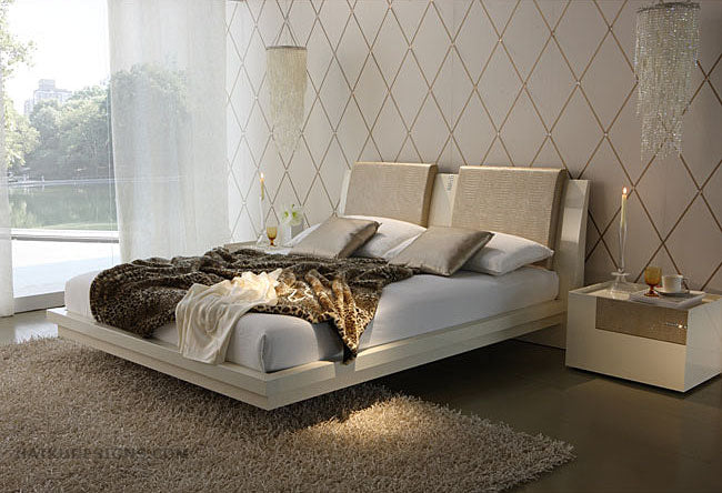 Double bed that seems to be floating off the floor in a beige and cream room