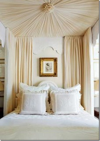 Cream and beige bedding with cream bed canopy and four poster curtains