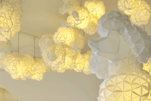 Geometric paper lantern lampshades, that resemble flowers