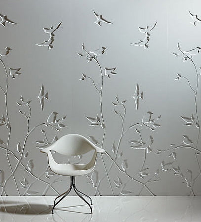 Embossed wall art of branches and birds on a grey wall