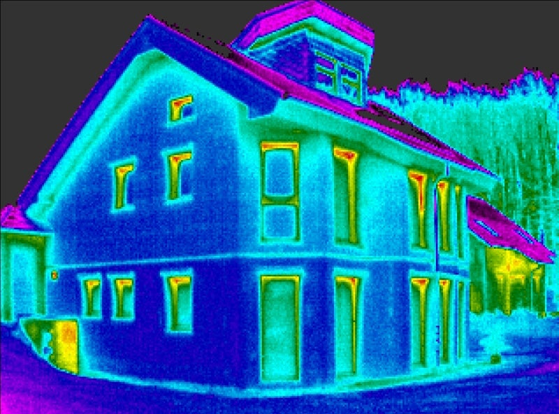 An infra red thermal image of a house, showing where heat is escaping
