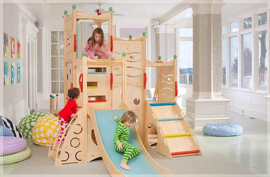 Wooden indoor climbing frame with slide and steps