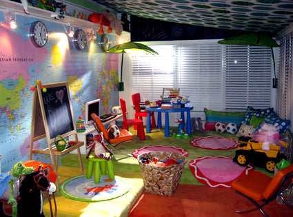 Kids room with world map wall and lots of fun and creative toys