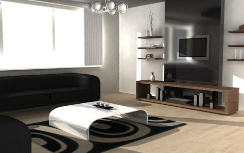Modern and clean black and white living room, with laminate wood flooring