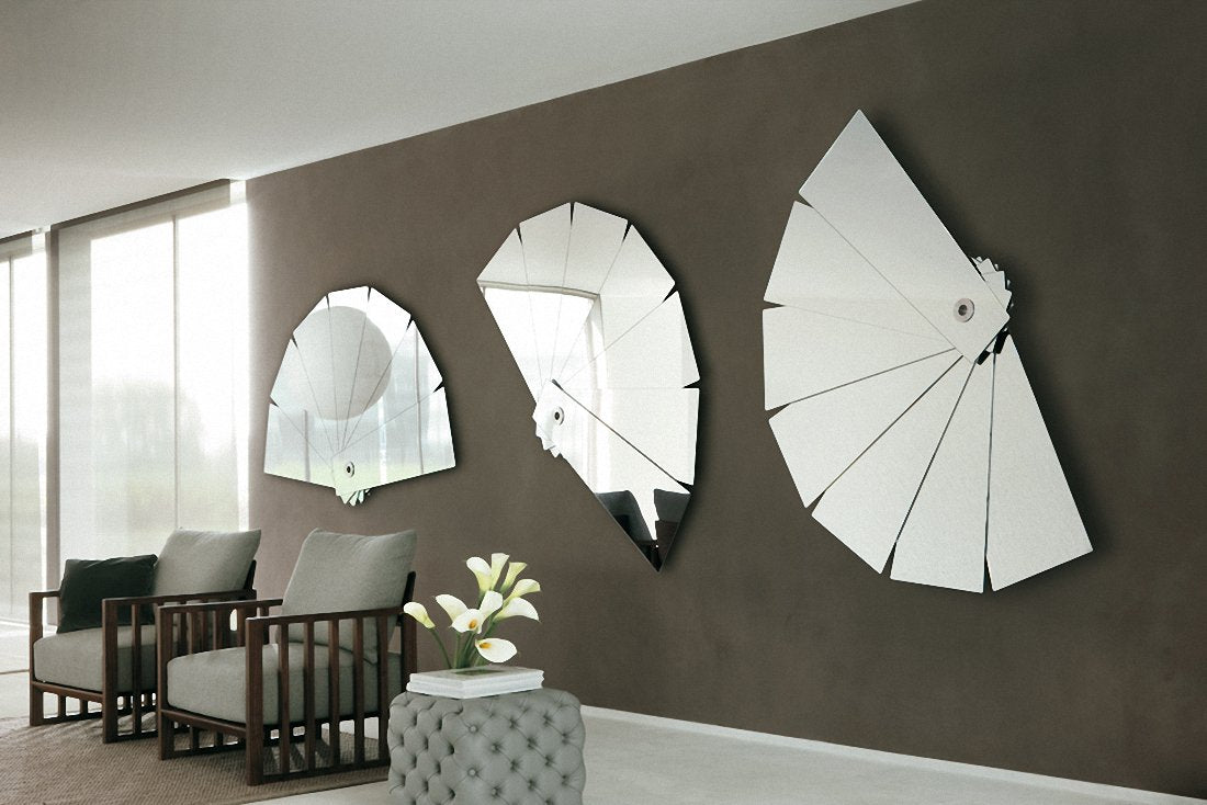 Three concertina fan style mirrors on a brown wall