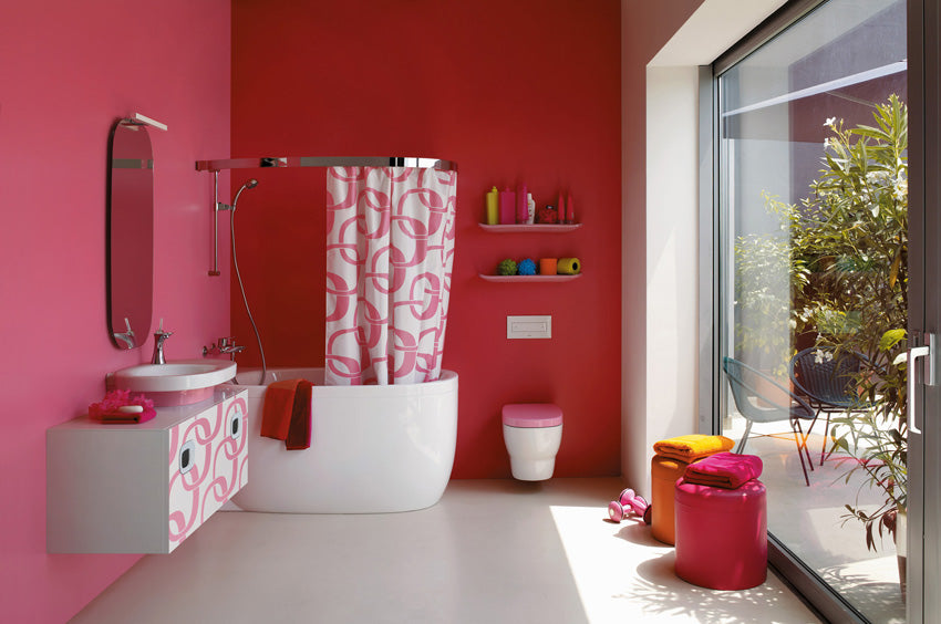 Pink and red downstairs toilet and shower room, with large window looking into the garden