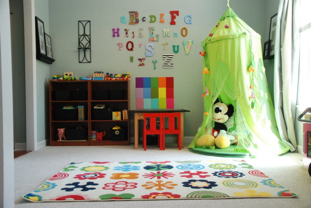 Bright kids room with bright green play tent and alphabet letters on the walls