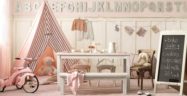 Light pink and cream bedroom with pink tent and white tea party table