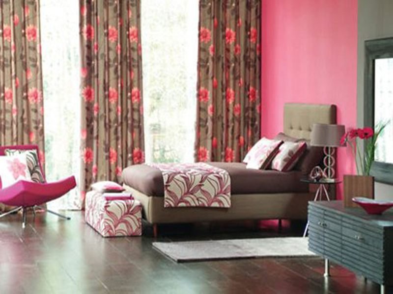 Brown and pink bedroom with single bed and brown and pink floral curtains