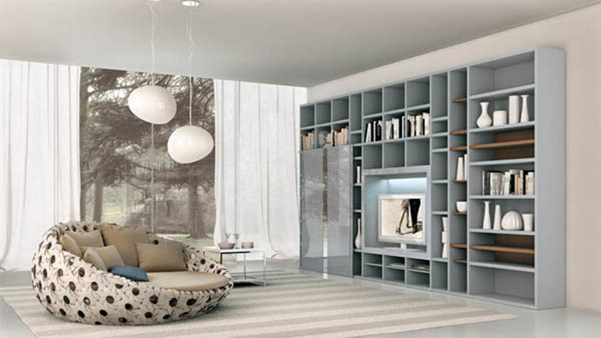 Cream and beige living room with wall of grey shelves and cosy cuddle two seater chair