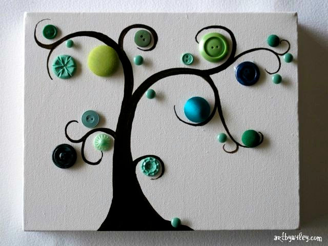 A white canvas with black tree painted on it, then real buttons create 3D leaves and fruit