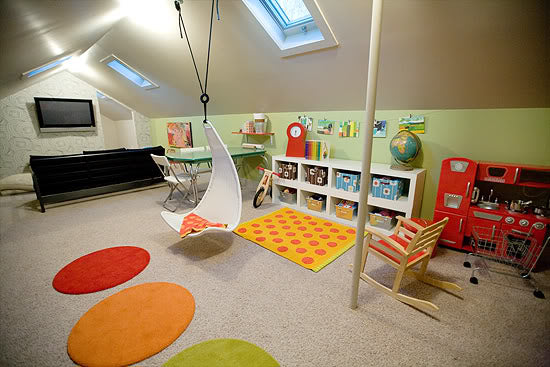 Kids loft play area with hanging chair, colour rugs and toy storage boxes