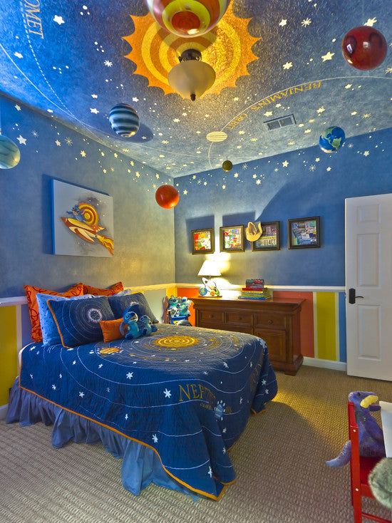 Blue space themed bedroom with planets hanging from the ceiling and a sun design surrounding the light fixture