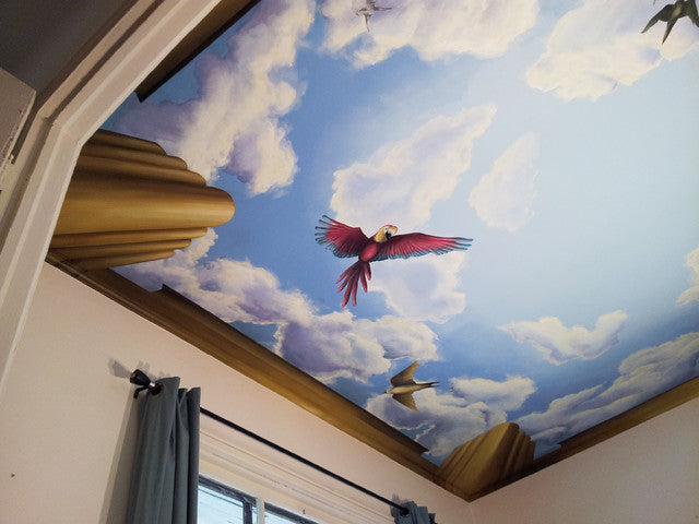 Ceiling art of a blue sky with clouds and birds flying, including a parrot