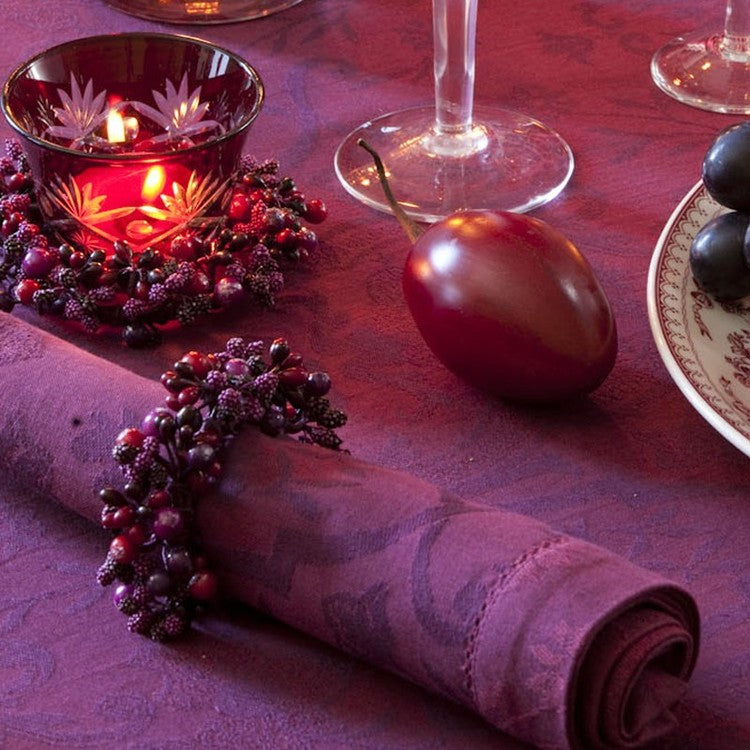Purple Christmas themed table decorations and place settings