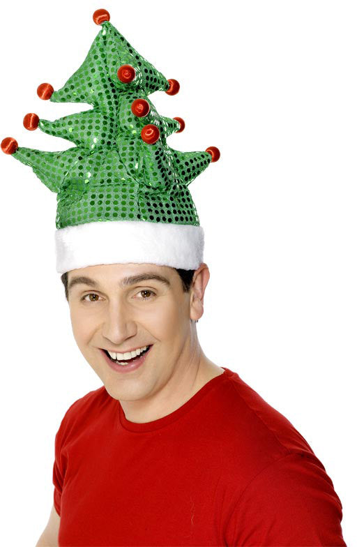 A man wearing a festive green novelty Christmas tree hat