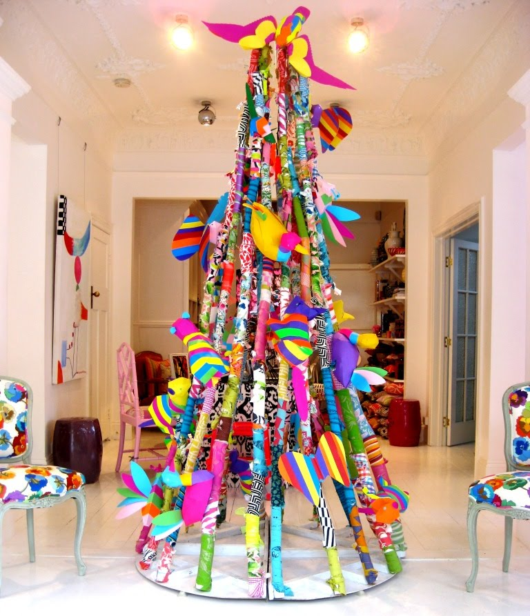 A brightly coloured fabric Christmas tree, which resembles a May pole
