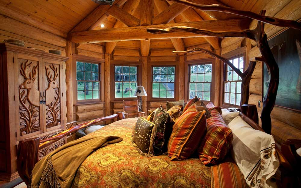 Cosy log cabin bedroom with exposed beams and wooden wood panels