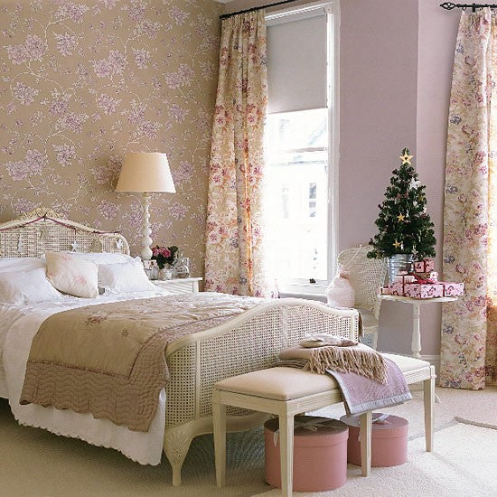 Beige bedroom with beige and pink floral wallpaper and matching curtains, and a blush pink painted wall