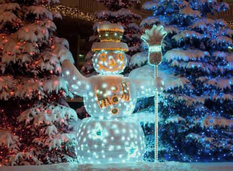 A snowman decoration with light blue glowing lights over its body
