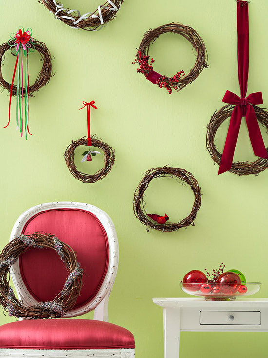 Light green wall with twig Christmas wreaths hung on the wall