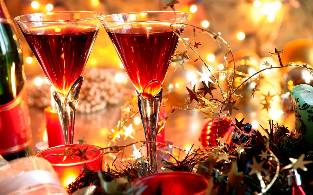 Two wine glassess on a festive Christmas table