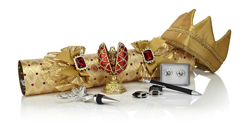 Gold Christmas cracker with examples of prizes in contains