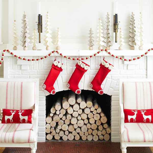 White brick fireplace with red stockings