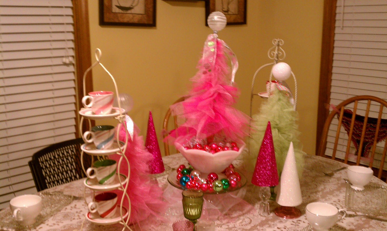 Festive pink decorations and baubles on a table
