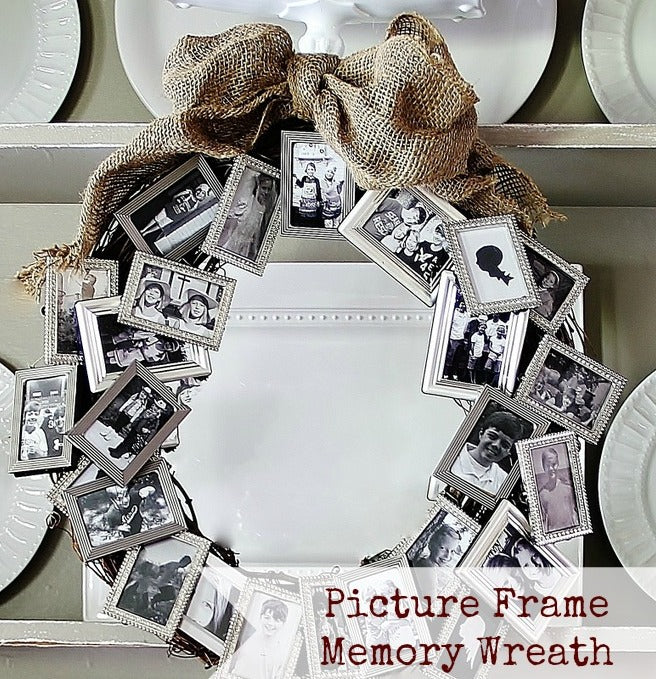 A burlap sack bow, twig wreath and photo frames attached all the way round
