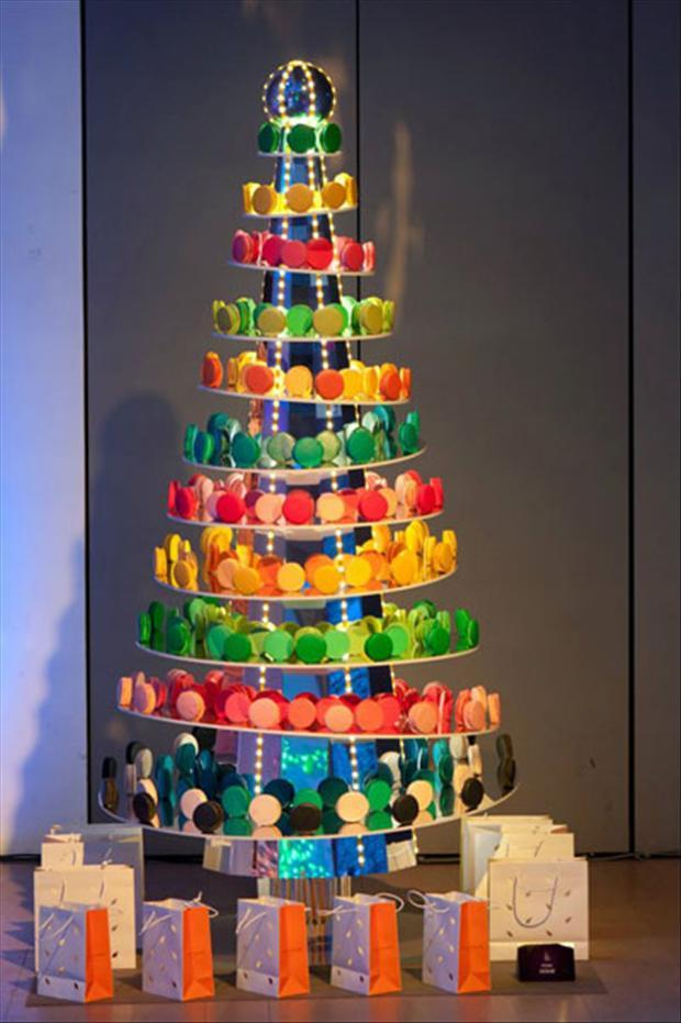 A Christmas tree made from a cone shaped set of shelves, with coloured macarons on each shelf