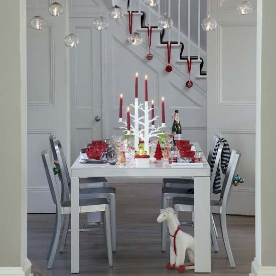 White dinign room with touched of red festive decorations
