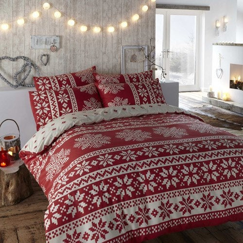 Red and white festive bedding with a snowflake pattern