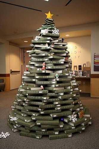 A Christmas tree in a library reception, made from books