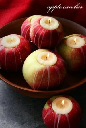 Cored apples used to hold tea lights in a bowl