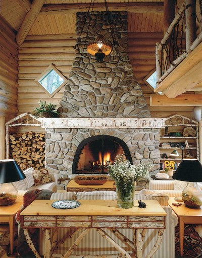 Stone fireplace in a rustic and cosy log cabin