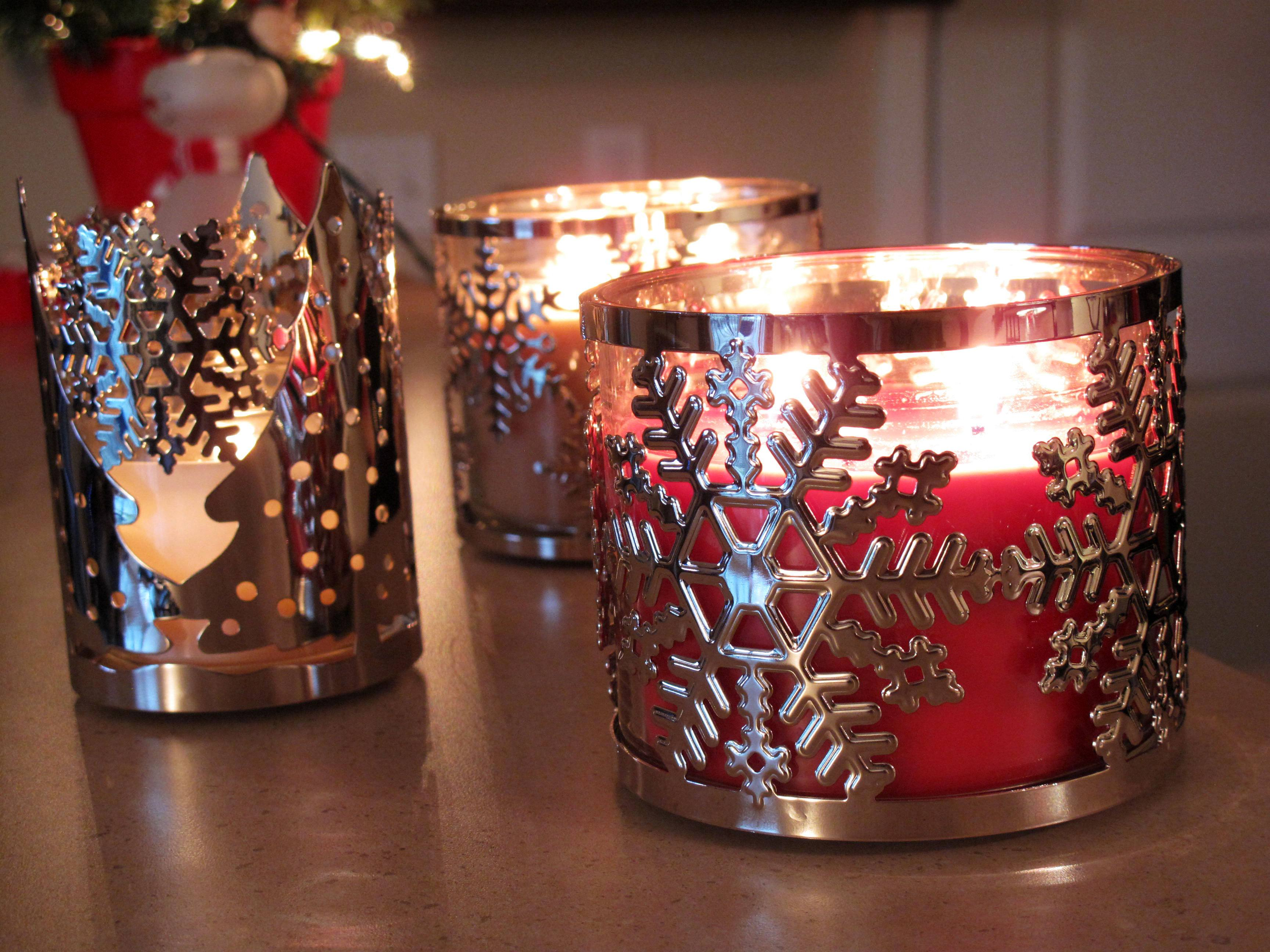 Festive metal candle holders with tree and snowflake designs