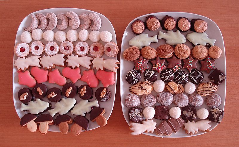 Collection of different cookies and biscuits on two plates