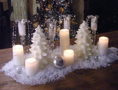 Decorative Christmas table display of white candles