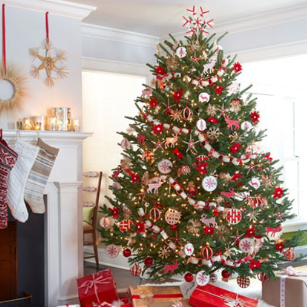 Christmas tree with lovely decorations and ornaments in a festive white living room