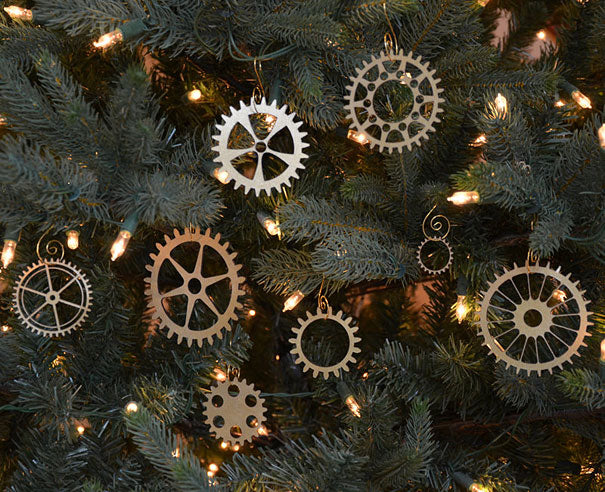 Metal gear cogs hung on a tree as Christmas decorations
