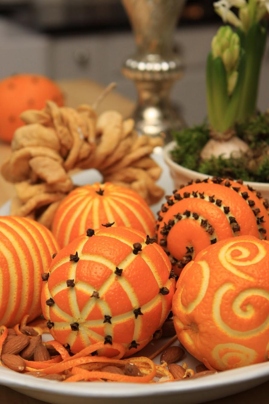 Oranges in a bowl carved with swirls and geometric patterns