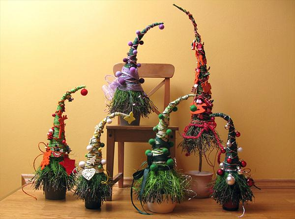 Small Christmas trees that look like witches hats, around a wooden chair