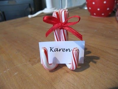 Red and white candy canes used to hold a name card for Karen