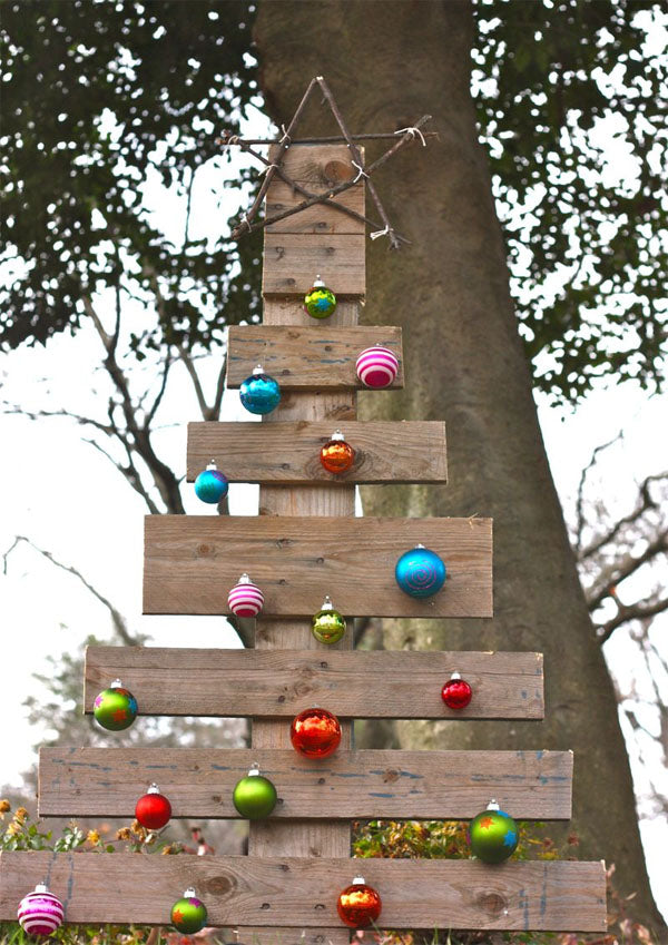 Wooden plank Christmas tree covered in coloured baubles