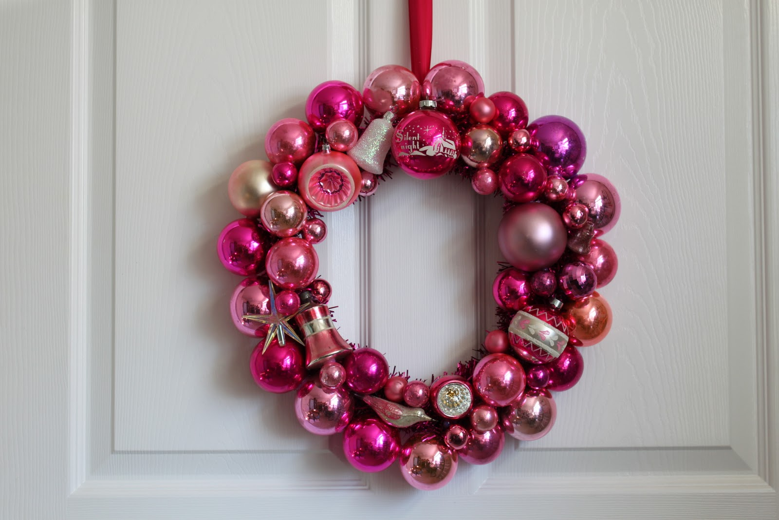 Pink baubles stuck together to make a front door Christmas wreath