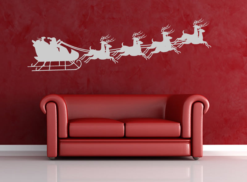 Dark red sofa and wall colour, with white Santa, sleigh and Reindeer decal