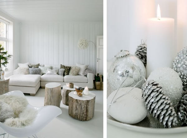 White living room with white sofa and three large logs used as coffee tables