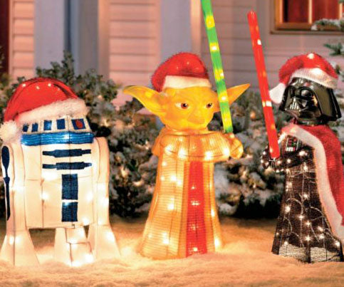 Front garden glowing Christmas ornaments of R2D2, Yoda and Darth Vader
