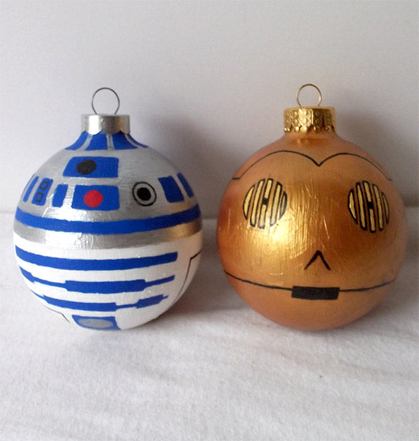 Two homemade round Christmas baubles, one made to look like R2D2 and the other C3PO